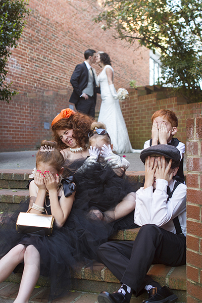 ew kissing hide your face wedding picture